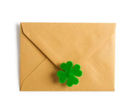 Closed brown envelope with four leaf clover for Patricks Day clipping path included Stock Photo - 17077516