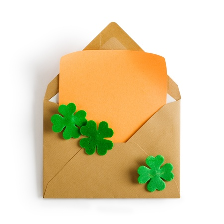 Open brown envelope with four leaf clover and notepad for Patricks Day clipping path included Stock Photo - 17077474