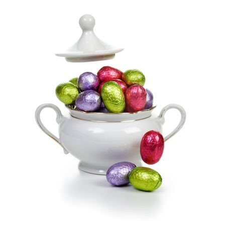 sugar bowl: Sugar bowl with chocolate candy Easter eggs wrapped in foil clipping path included Stock Photo