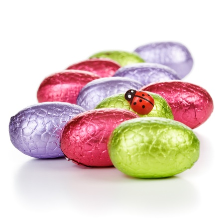Chocolate candy Easter eggs wrapped in foil with ladybug clipping path included Stock Photo - 17077462