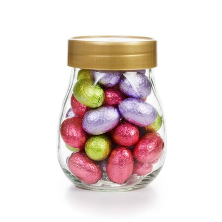 Closed glass jar with chocolate candy Easter eggs wrapped in foil clipping path included Stock Photo - 17077460