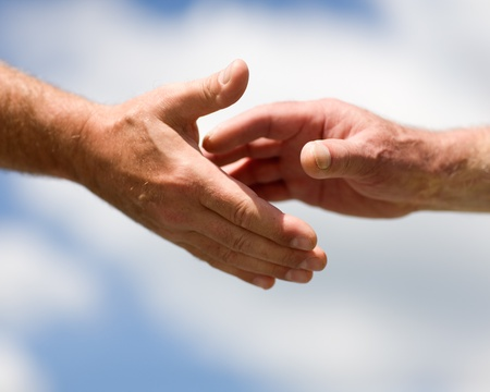 missionary: Two hands reaching out to each other