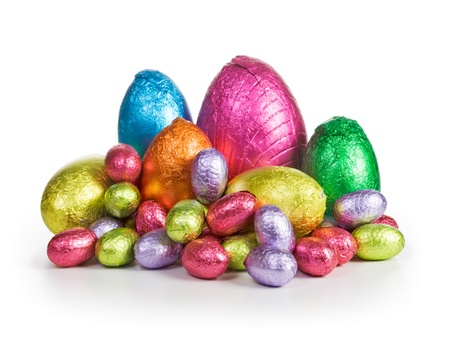 Large group of chocolate candy Easter eggs wrapped in foil photo