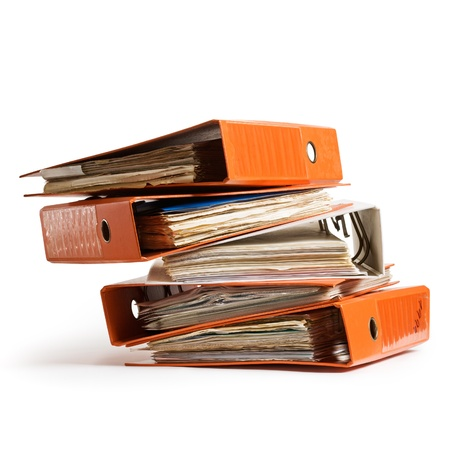 Stack of orange old ring binders on white background clipping path included