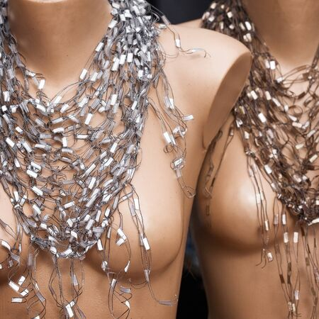 female likeness: Mannequins with scarf necklace at market in Turkey