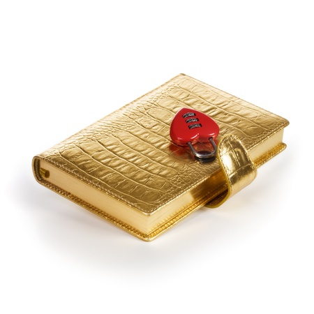 Luxury golden diary with heart shape padlock on white background photo
