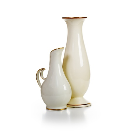 Group of old white porcelain vases on white background photo