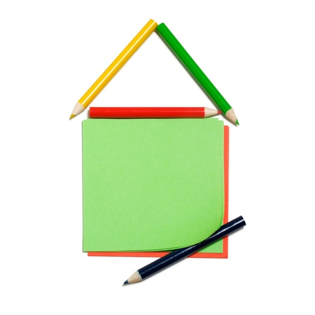 House made of colorful pencils and paper notes on white background, clipping path included photo