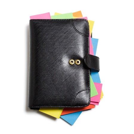 Black notebook with colorful note papers on white background, clipping path included photo