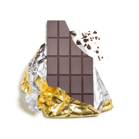 Broken chocolate bar wrapped in foil on white background,