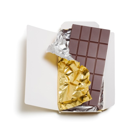 Chocolate bar wrapped in foil with open cardboard on white background, clipping path included