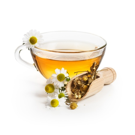 chamomile tea: Herbal tea with chamomile flowers on white background Stock Photo
