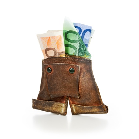 Old brown lederhosen leather purse with euro banknotes on white background photo