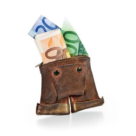 Antique lederhosen wallet with euro notes on white background photo