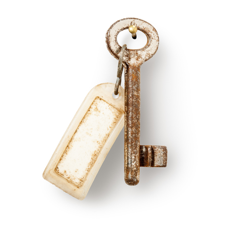 key fob: Old key and dirty key fob hanging on nail   Stock Photo