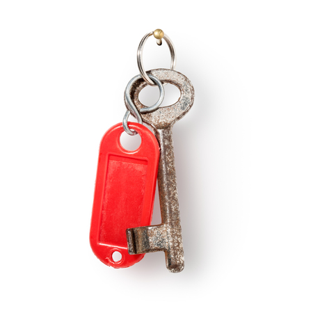 key fob: House old key and red key fob hanging on nail