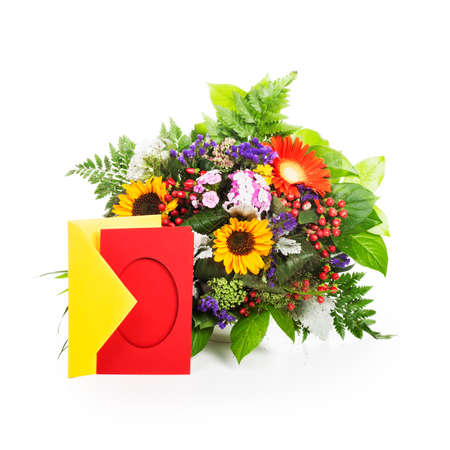 Beautiful bouquet of summer flowers with envelope and card on white background photo