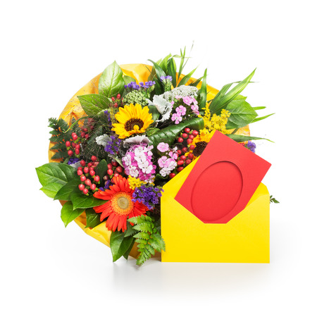 Bouquet of summer flowers with yellow envelope and red card on white background photo