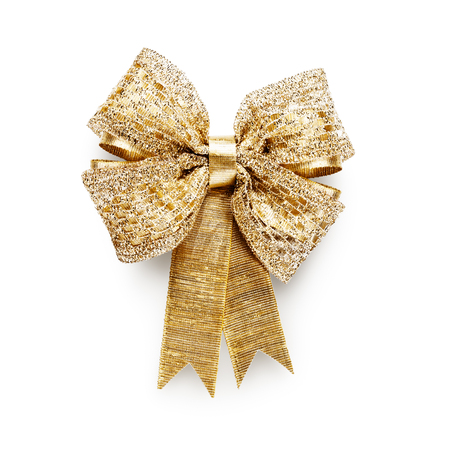 Gold ribbon bow isolated on white background clipping path included