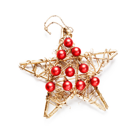 Christmas decoration with red baubles as christmas tree and gold wooden star on white background photo