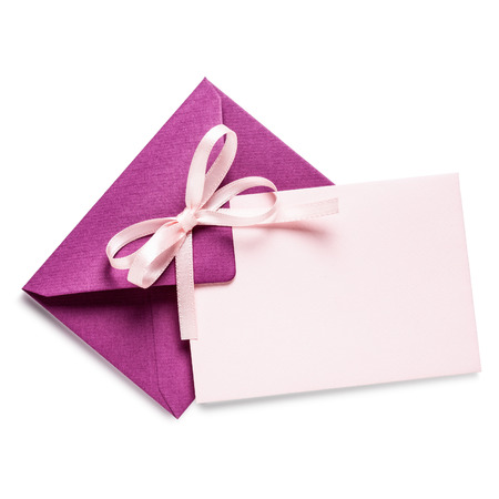 Pink envelope with card and bow ribbon on white background Stock Photo