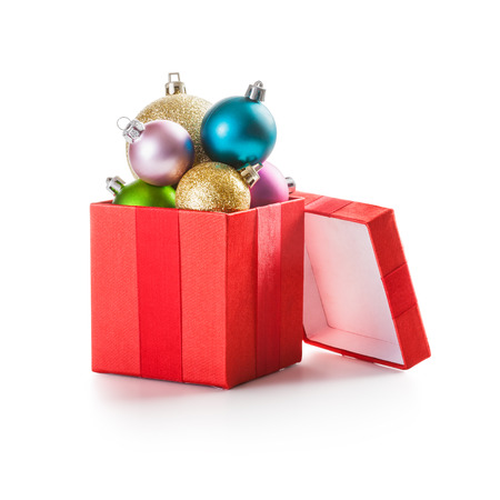 Red gift box with christmas balls on white background clipping path included photo