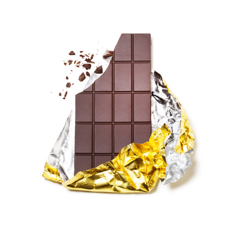 Broken chocolate bar wrapped in foil on white background photo