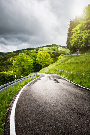 rough road: Road on the spring hills landscape. Black Forest Schwarzwald in Germany