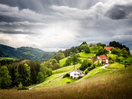 small country town: Beautiful hill landscape with small village and fir trees. Black Forest Schwarzwald, Germany. Stock Photo