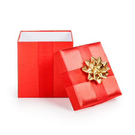 Open red gift box with gold ribbon. Christmas theme. Object isolated on white background. Clipping path.