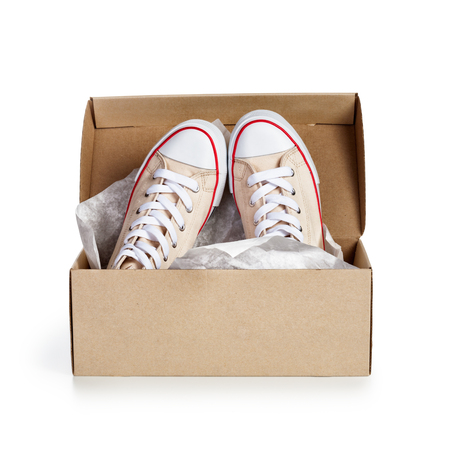 Shoe box with pair of new sneakers isolated on white background. Object with clipping path photo