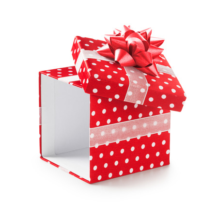 traditional gifts: Open red gift box with white dots and ribbon bow. Holiday present. Object isolated on white background. Clipping path
