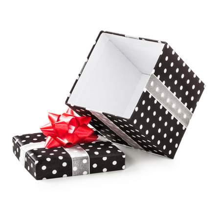 traditional gifts: Open black gift box with white dots and red ribbon bow. Holiday present. Object isolated on white background. Clipping path