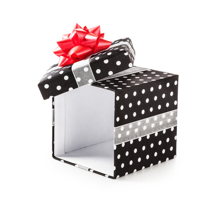 ribbon bow: Open black gift box with white dots and red ribbon bow. Holiday present. Object isolated on white background. Clipping path