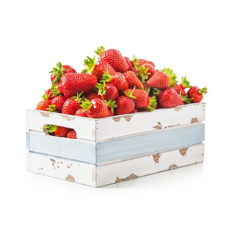 Fresh strawberries in old wooden crate isolated on white background. Healthy eating. Object with clipping path