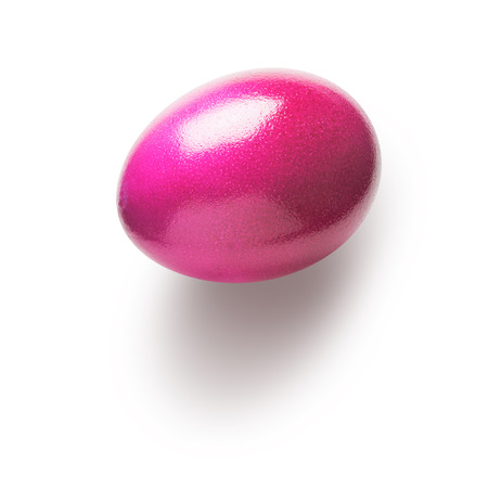 holiday symbol: Pink painted easter egg isolated on white background. Holiday symbol. Single object with clipping path