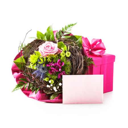 celebration background: Bouquet of flowers, pink gift box and invitation card isolated on white background. Holiday present. Objects group with clipping path