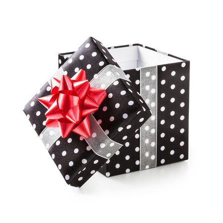 open box: Open black gift box with white dots and red ribbon bow. Holiday present. Object isolated on white background. Clipping path