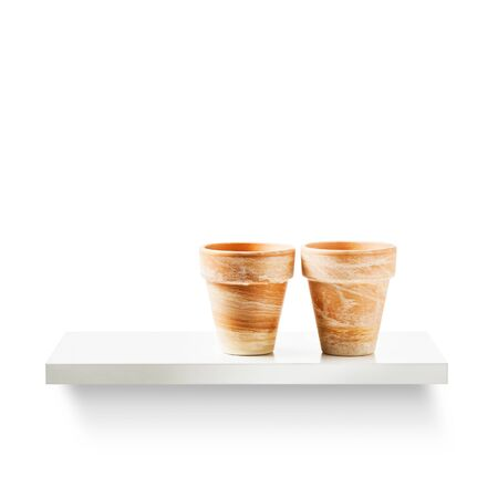 objects equipment: Two clay flower pots on shelf isolated on white background. Garden equipment. Group of objects with clipping path Stock Photo