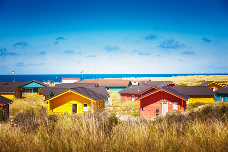 sea of houses: Colorful beach houses in dune grass at the beach of Helgoland, North sea, Germany. Travel destinations. Selective focus Stock Photo