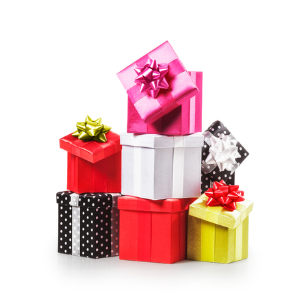 surprise gift: Stacked gift boxes with ribbon bow. Christmas present. Croup of objects isolated on white background. Clipping path