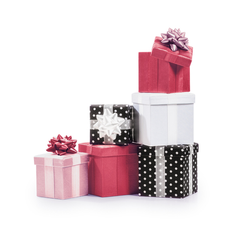 celebration event: Stacked gift boxes with ribbon bow. Holiday present. Croup of objects isolated on white background. Clipping path Stock Photo