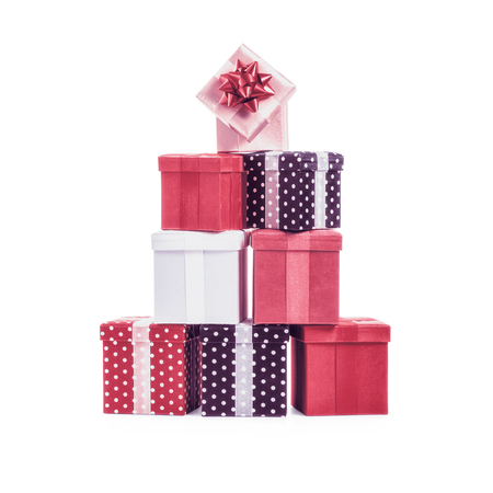 christmas objects: Stacked gift boxes with ribbon bow. Christmas present. Croup of objects isolated on white background Stock Photo