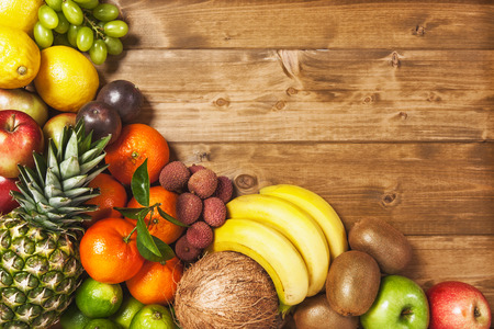 Fresh market fruits on wooden background. Healthy eating and dieting concept. Winter assortment. Copy space. Top view