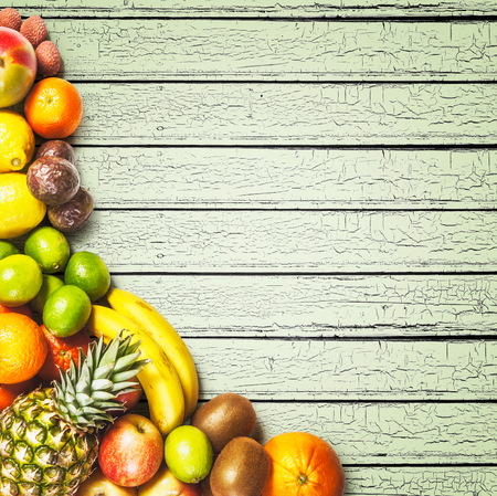 assortment: Fresh market fruits on wooden background. Healthy eating and dieting concept. Winter assortment. Copy space. Top view Stock Photo