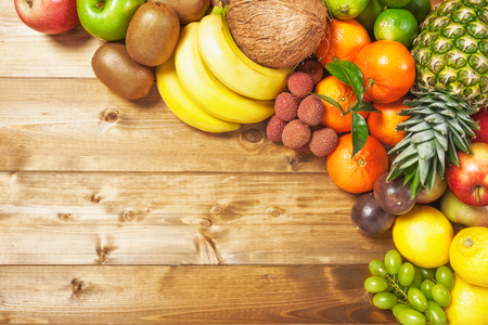assortment: Fresh fruits on wooden background. Healthy eating and dieting concept. Winter assortment. Copy space. Top view