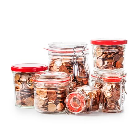 money background: Glass bank jars with coins isolated on white background. Saving money concept. Group of objects with clipping path Stock Photo