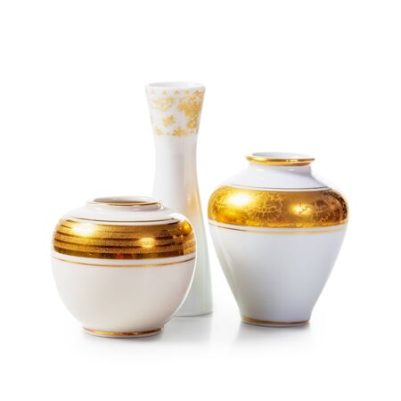 small group of objects: Three antique white porcelain vases on white background. Small objects group clipping path included Stock Photo