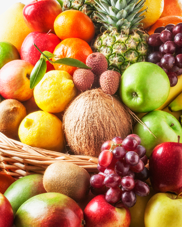 fruits in a basket: Basket of fresh fruits background. Healthy eating and dieting concept. Winter assortment Stock Photo