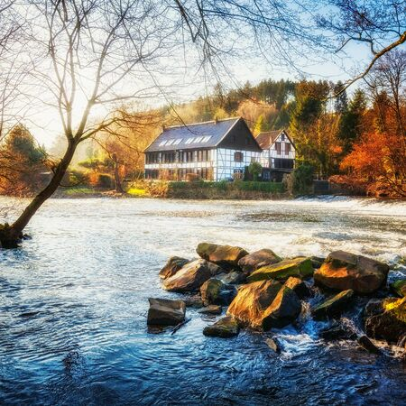 half timbered house: House on the river. Traditional half timbered houses in Germany Stock Photo